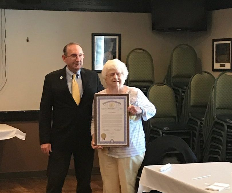 Lillian VanderVeen Receiving a proclamation from The State of Michigan Presented by State Representative Brann